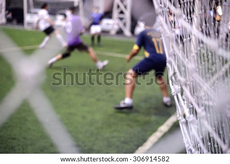 Soccer game action behind the soccer net - stock photo