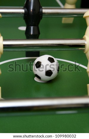 Soccer game and foosball pieces on the game table - stock photo
