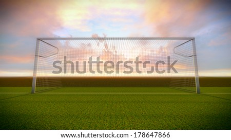 Soccer goal on the football field at sunset. - stock photo