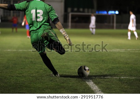 soccer goalkeeper hit the ball - stock photo