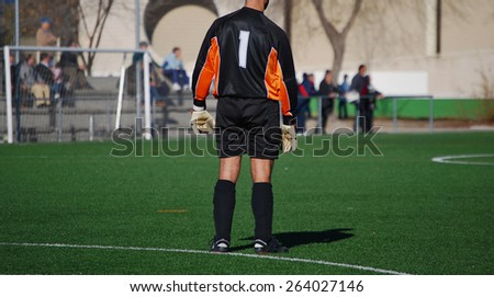 Soccer goalkeeper standing in the stadium. Number one - stock photo