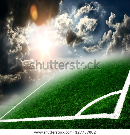 Soccer green field with beautiful sky - stock photo