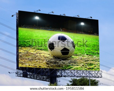 Soccer in the field advertising on billboard - stock photo