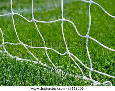 Soccer netting with grass. See more soccer images in my portfolio. - stock photo