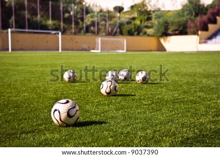 soccer or football ball in green grass - stock photo