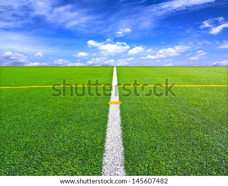 Soccer or football field over blue sky background - stock photo
