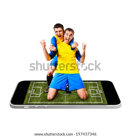 soccer or football player is celebrating on screen of modern phone - stock photo