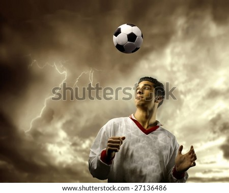 soccer player and a stormy sky - stock photo