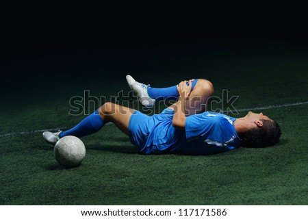 soccer player have pain injury accident on football game - stock photo