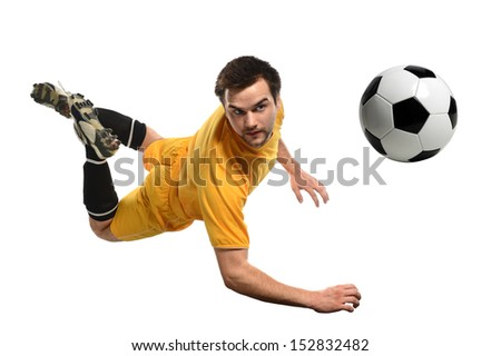 Soccer player heading ball isolated over white background - stock photo