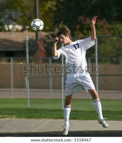 Soccer player hits ball with head. - stock photo