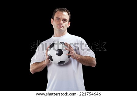Soccer player holding a ball - stock photo