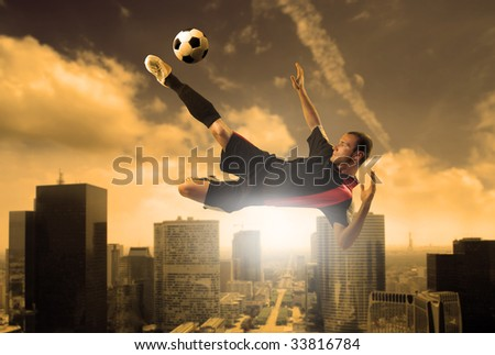 soccer player in action on a city background - stock photo