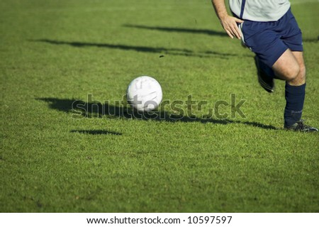 soccer player in action. running after ball on soccer field.