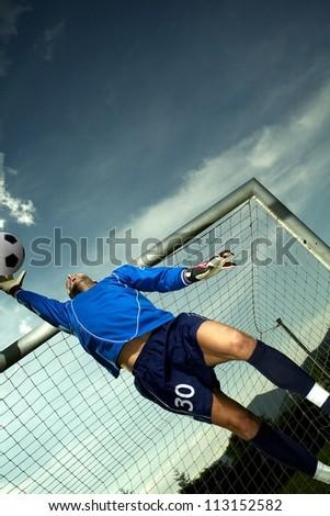 Soccer player in goal - stock photo