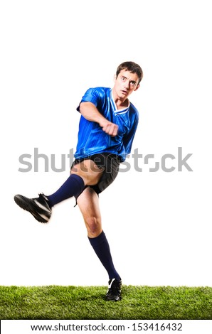 soccer player is kicking a ball isolated on white background - stock photo