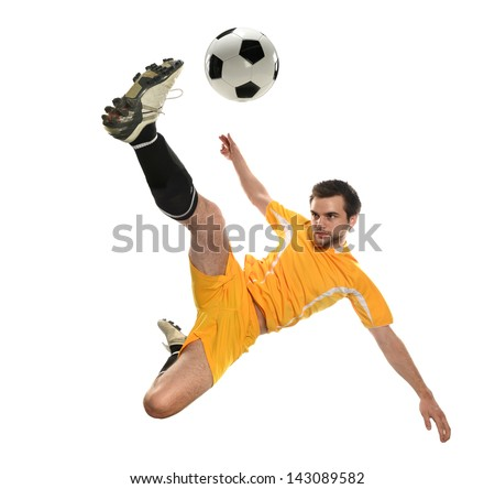 Soccer player kicking the ball isolated on a white background - stock photo