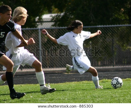 Soccer player moves ball down the field.  Editorial Use Only - stock photo