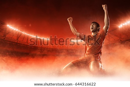 soccer player on soccer stadium celebrating a goal on red smoke background