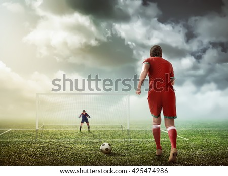 Soccer player ready to execute penalty kick - stock photo