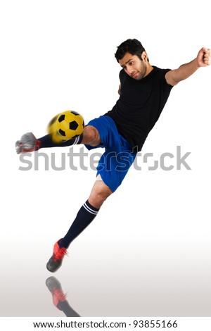 soccer player shooting the football - stock photo