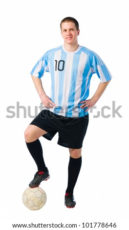 Soccer player standing with a ball, player in full image. - stock photo