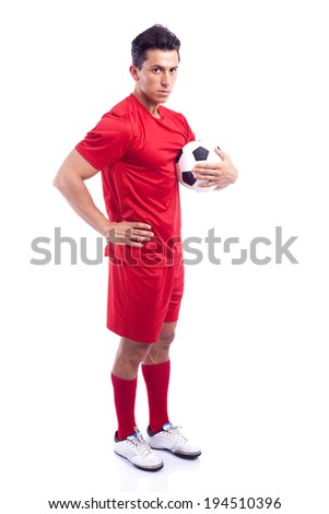 Soccer player standing with ball isolated on a white background - stock photo