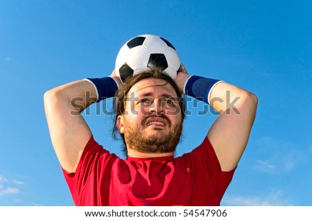soccer player taking throw-in - stock photo