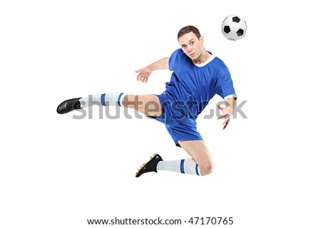 Soccer player with a ball in jump isolated on white background - stock photo
