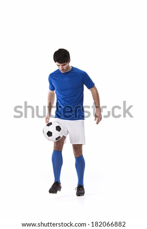 Soccer player with a soccer ball - stock photo