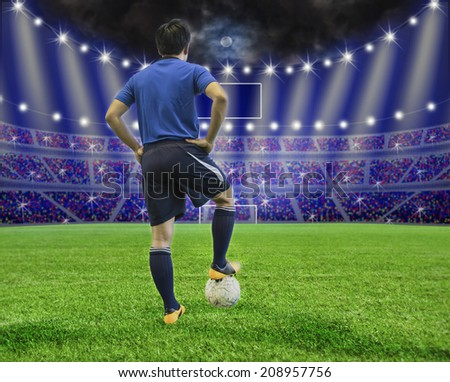 Soccer player with ball  at stadium. at night - stock photo