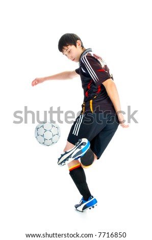 soccer player with ball isolated on white background - stock photo