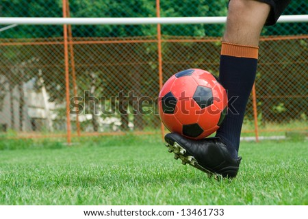 soccer player with ball on the grass