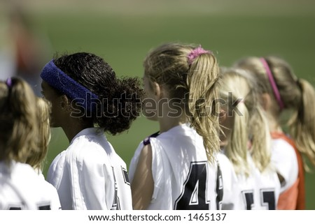 Soccer Players on the Sideline - stock photo