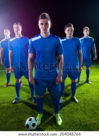 soccer players team group isolated on black background - stock photo