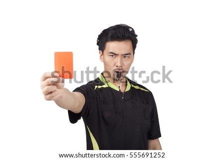 Soccer Referee Holding Penalty Card