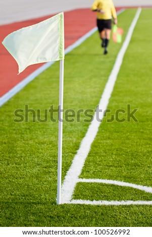 Soccer referee running along sideline - stock photo