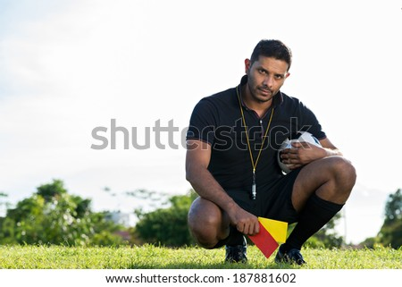 Soccer referee showing yellow and red cards - stock photo