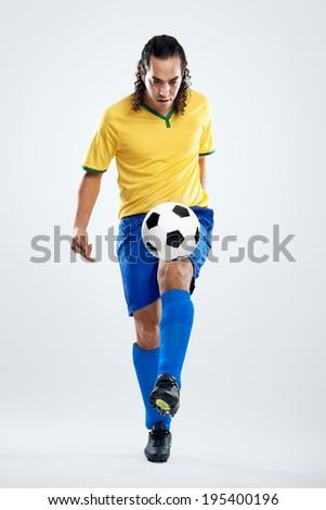 soccer skills football player in brasil kit for world cup brazil - stock photo