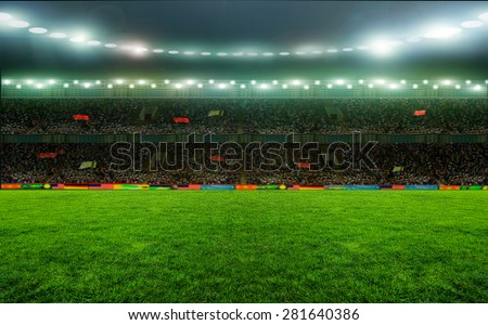 Soccer stadium, arena in night illuminated bright spotlights - stock photo