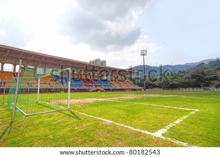 Soccer stadium , green grass and sky - stock photo