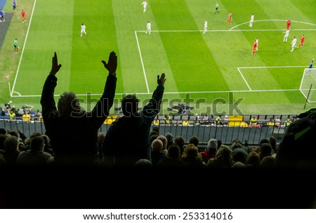 Soccer supporters complain for a bad decision of the referee. Spectator - stock photo