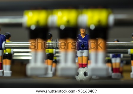 soccer table, close up three figures standing in front of the goal - stock photo