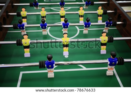 Soccer table game with yellow and blue players - stock photo