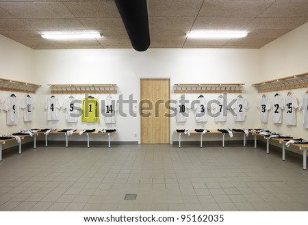 Soccer teams dressing room with numbered shirts - stock photo