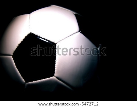 soccerball against a dark background horizontal - stock photo