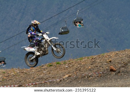 SOCHI, RUSSIA - AUGUST 16, 2014: Off-road motorcycle rider trains in summer mountains - stock photo