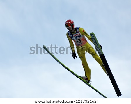 SOCHI, RUSSIA - DECEMBER 9: FIS Ski Jumping World Cup in Sochi on December, 9, 2012. Jump Danny Queck. - stock photo