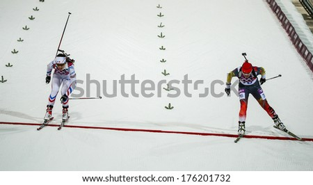 Sochi, RUSSIA - February 9, 2014: Anais CHEVALIER (FRA) at Biathlon Women's 7.5 km Sprint at Sochi 2014 XXII Olympic Winter Games - stock photo