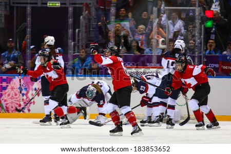 Sochi, RUSSIA - February 20, 2014: Canadian Women's Ice hockey team celebrating gold medals, after Gold Medal Game vs. USA team at the Sochi 2014 Olympic Games - stock photo